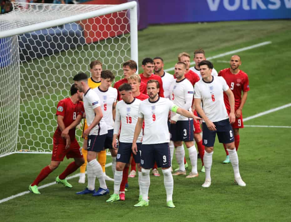 A congested England penalty area as the players wait for a corner.