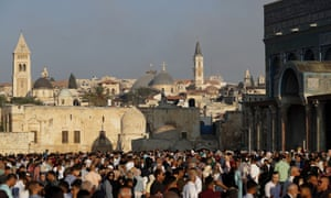 People gather near the Dome of the Rock at al-Aqsa Mosque compound in Jerusalem's old city