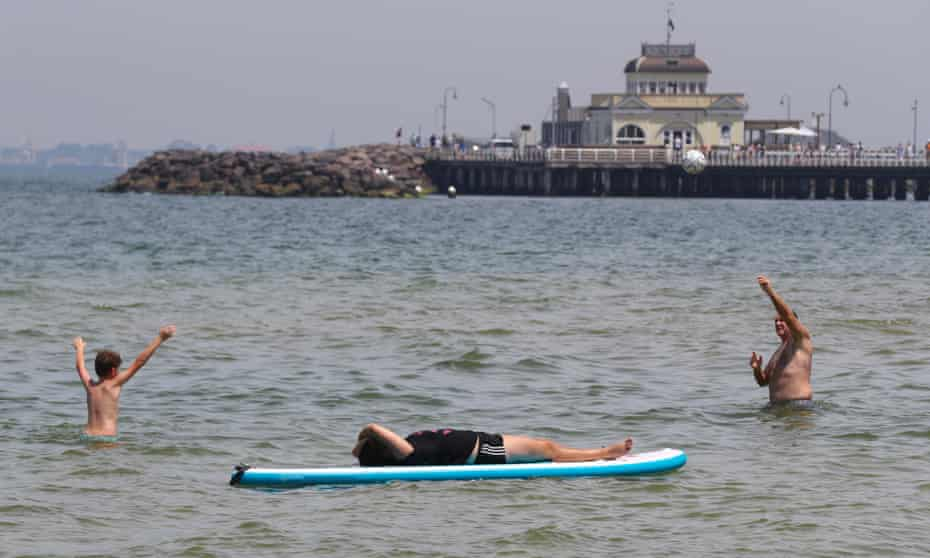Beachgoers cool off at St Kilda beach in Melbourne. Extreme heatwave in Australia brought temperatures in mid-40s to northern Victoria, weather records broken elsewhere as heat forecast to continue