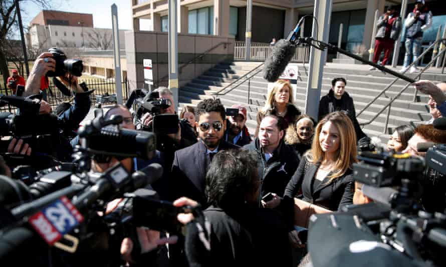 Smollett surrounded by media as he leaves court.