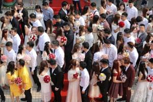 Kuala Lumpur, Malaysia: Newlyweds kiss during a mass wedding in Kuala Lumpur, Malaysia