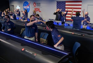 The team in mission control reacts to confirmation that the spacecraft successfully touched down on Mars.