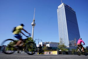 Cyclists ride near the TV tower during the Car-Free Day in the German capital