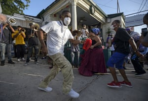 New Orleans, US Sylvester Frances Jr dances to a brass band to celebrate the life of his father, Sylvester 'Hawk' Francis, who died on Tuesday in front of the Backstreet Cultural Museum, which he founded