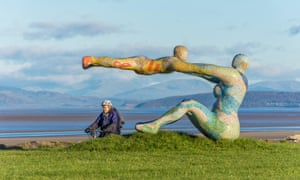 The Venus and Cupid sculpture on Morecambe Promenade at Scalestones Point looking out over the Bay and the Lake District hills.