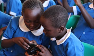 School children learning to use cameras in preparation for the Kids Twiga Tally, a count of giraffes in Laikipia County, Kenya, March 2016.