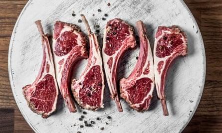 Fresh raw lamb ribs on a white cutting board