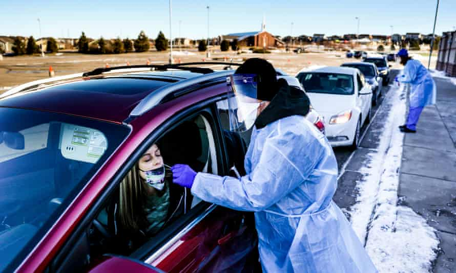 Bradford Christopher administers a Covid test on Wednesday in Parker, Colorado. The site is one of the closest testing sites to Ebert county, where the first US case of the new Covid-19 variant was found.