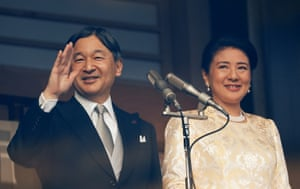 Japan's emperor Naruhito and empress Masako wave to well-wishers during a public appearance for new year in Tokyo.