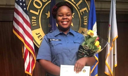 Breonna Taylor, an EMT, poses during a graduation ceremony in Louisville, Kentucky.