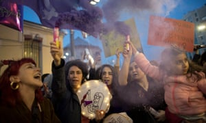 Thousands of women shout slogans as Turkish police block the roads during a rally marking the International Women's Day at Istiklal Street in Istanbul, Turkey