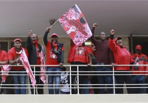 Members of the National Education, Health and Allied Workers' Union (NEHAWU) rally in Cape Town.