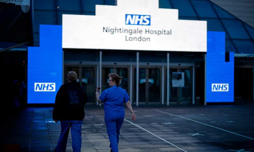 Medical staff outside the Nightingale hospital in the ExCeL centre, London.
