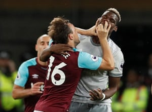 Noble gets to grips with Pogba.