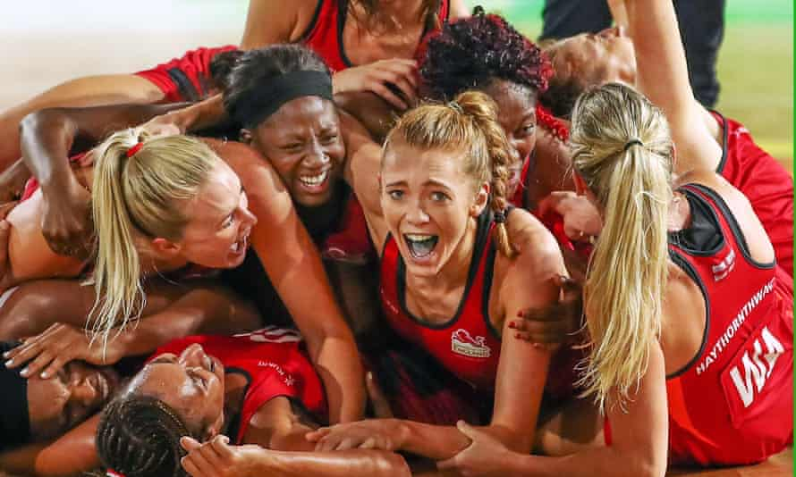 Helen Housby, centre, celebrates with her Engladn teammates after winning the Netball gold medal match between England and Australia on day 11 of the Commonwealth Games.