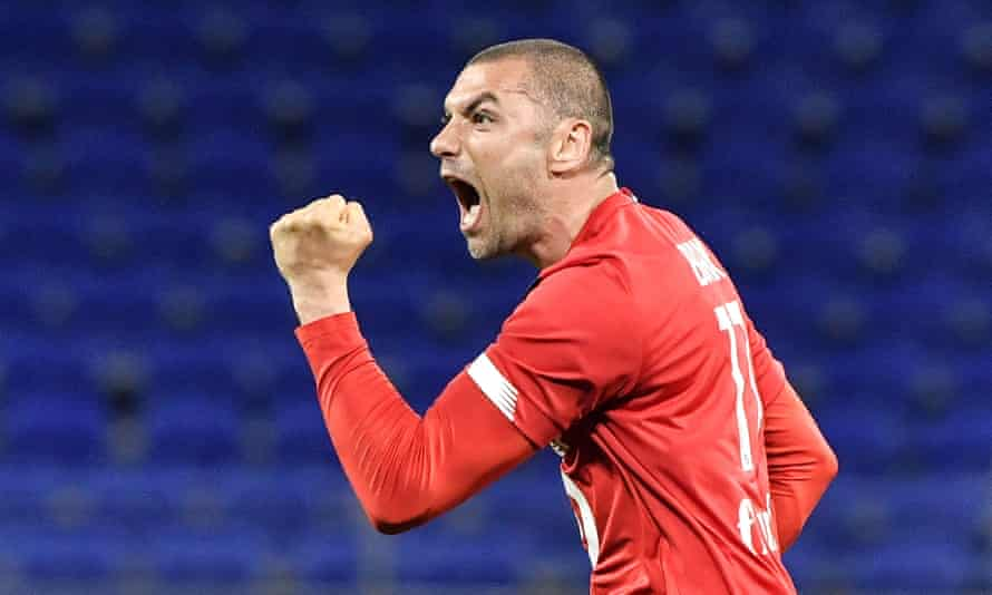 Burak Yilmaz celebrates after scoring for Lille in their comeback victory against Lyon in Ligue 1.