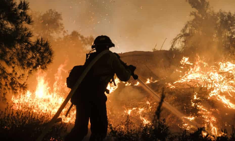 A firefighter battles a wildfire in California