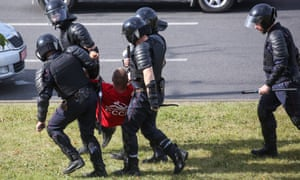 Police detain a man on Wednesday who tried to put flowers at the site where a protester died in Minsk, the capital of Belarus.