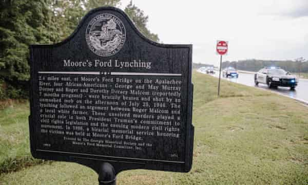 The historical marker sign at the roadside near the site of the Moore's Ford Bridge lynching.