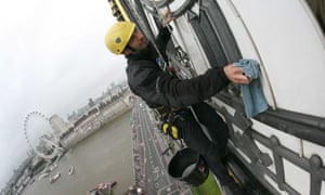 Allan Davies, a technician, cleaning Big Ben clock.