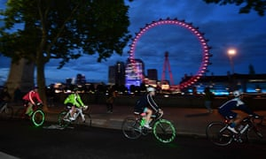 Cyclists ride along Victoria Embankment, in London.