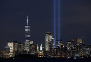 New York, USThe annual Tribute in Light illuminates the skyline of lower Manhattan behind the Statue of Liberty on the eve of the 18th anniversary of the 9/11 attacks, as seen from Bayonne, New Jersey