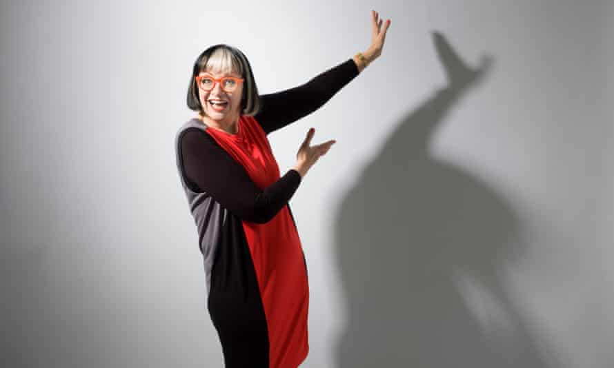 Philippa Perry in a red and black dress and plastic orange-rimmed glasses