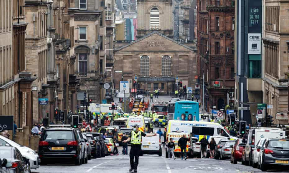 Police cordon off the city centre around West George Street in Glasgow after the fatal stabbing incident at the Park Inn Hotel on 26 June 2020.