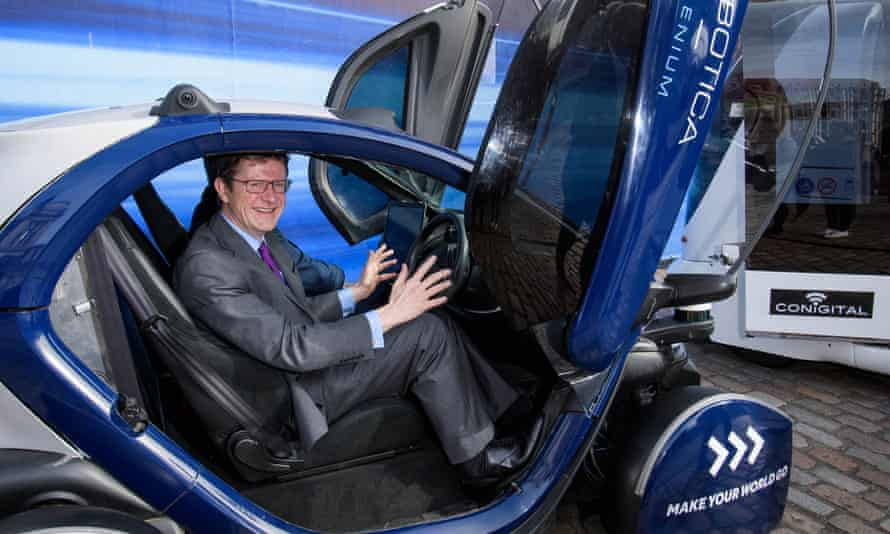 Greg Clark, the Business, Energy and Industrial Strategy secretary, sits in a self-driving pod