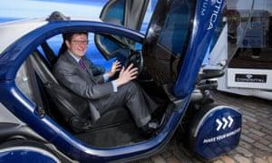 Business secretary Greg Clark in a self-driving pod
