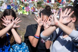 Marjory Stoneman Douglas high school walkoutepa06603773 From left, Isabel Guri, Meagan McGinty and Kaelyn Bracco, students of the Marjory Stoneman Douglas High School, crosses their hands showing a the words 'Don't shoot' during the national school walkout outside the Marjory Stoneman Douglas High School in Parkland, Florida, USA, 14 March 2018. Organizers of the 17-minute protest, one minute for each victim of the Stoneman Douglas High School shooting that took place on 14 February, hope to call attention to Congressional inaction on the issue. EPA/CRISTOBAL HERRERA