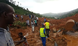 Rescue workers at the site of the mudslide in Freetown, Sierra Leone, that has so far claimed almost 400 lives