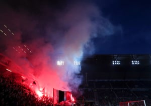 Rennes fans light flares during the Europa League match against Arsenal on 7 March 2019.