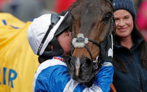Frost celebrates victory with Frodon in the winners' enclosure aftert the Ryanair Chase