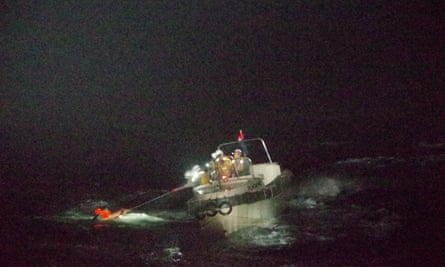 A crew member believed to be from Gulf Livestock 1 is rescued by Japan's coastguard.