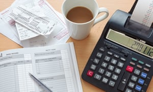 Still life bookkeeping photo of a sales ledger with a pile of receipts, invoices and a print calculator