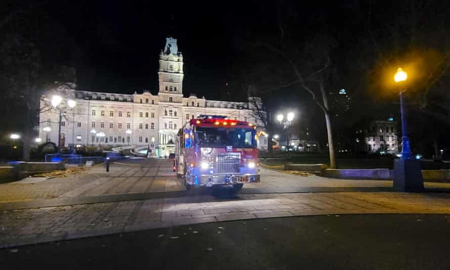 A fire engine is parked in front of the National Assembly in Quebec City after two people were killed in an attack