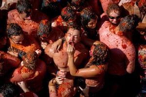 Participants pelt each other with tomato pulp