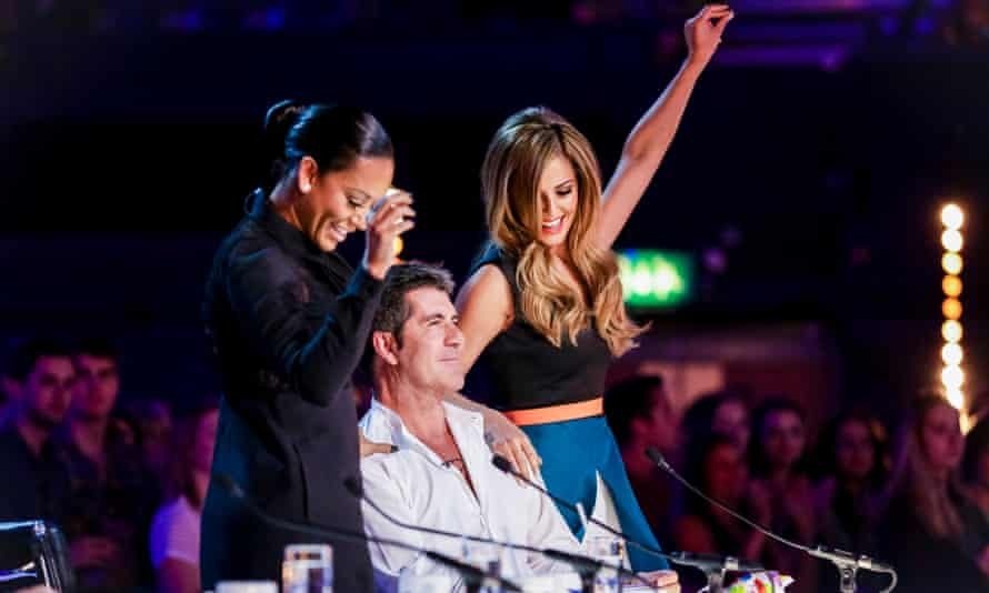 Mel B with Simon Cowell and Cheryl on X Factor in 2014.