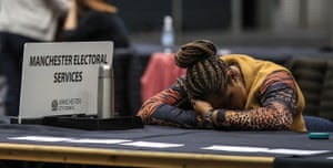 A volunteer counter takes a break during the European Parliamentary elections count at the Central Convention Complex in Manchester.
