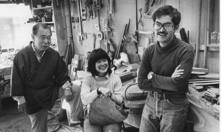 George Nakashima, left, with his children Mira and Kevin in the workshop at New Hope during the 1980s.