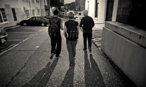 Homeless young adults walk through an alley on their way to a homeless shelter in Seattle's University district.
