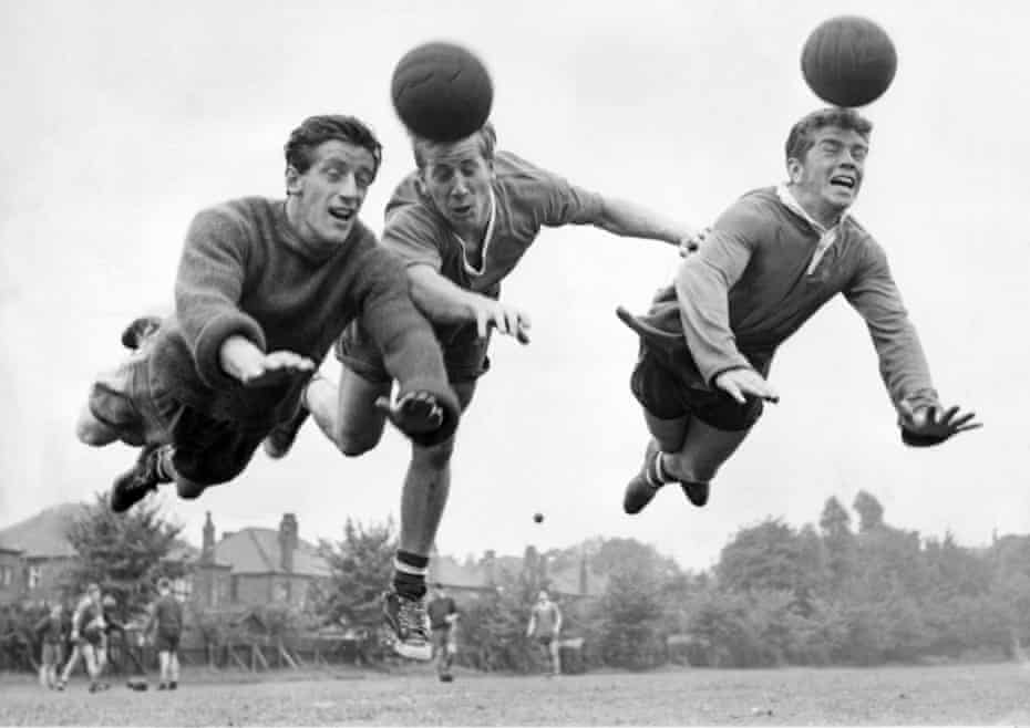 Dennis Viollett, Bobby Charlton and Johnny Giles practice heading during Manchester United training in 1960
