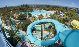 Slides and palm trees at Costa Caribe Aquatic, Spain