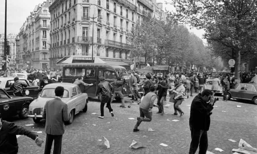 Protesters attack a police vehicle on Boulevard Saint Germain, May 1968.