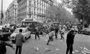 Protesters attack a police vehicle on Boulevard Saint-Germain during the 1968 riots in Paris