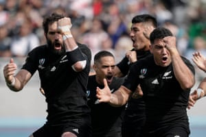 New Zealand players perform the haka before their Pool B victory against Namibia at Tokyo Stadium.
