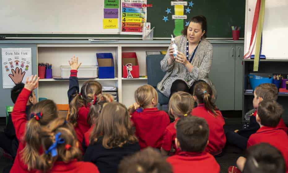 Prep teacher Rachel Gathercole speaks about sanitiser to students at Lysterfield primary school in Melbourne, Australia in May 2020