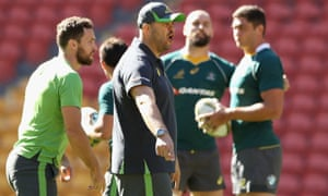 The Australia coach, Michael Cheika, talks to his players during a training session