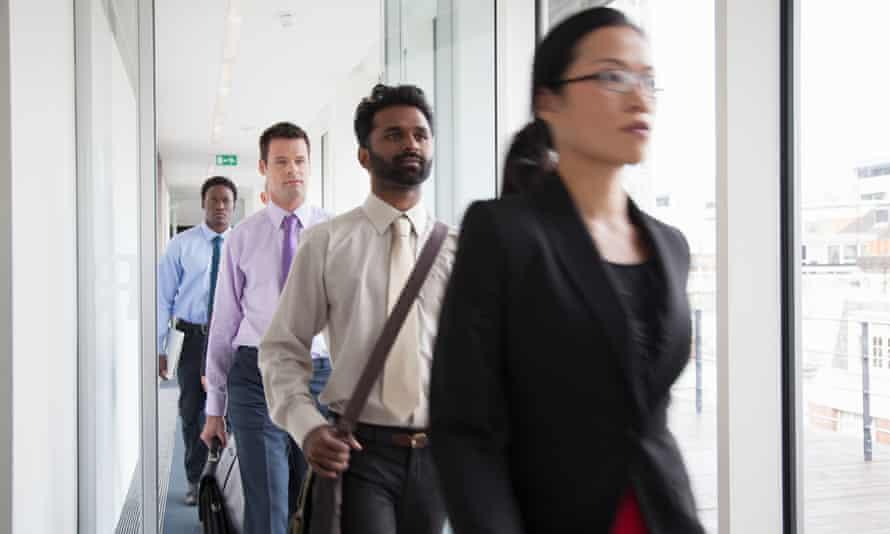 Office workers walking down a corridor